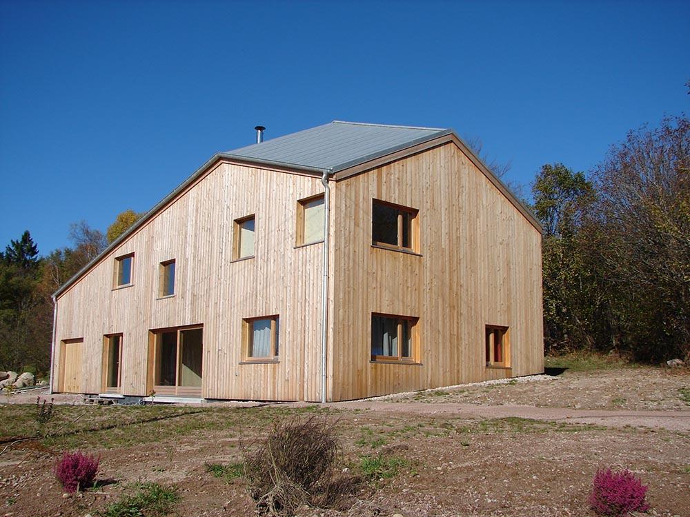 Construction ossature bois maison contemporaine atelier for Maison ossature bois contemporaine prix